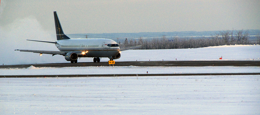 Plane landing at Peace River Regional Airport